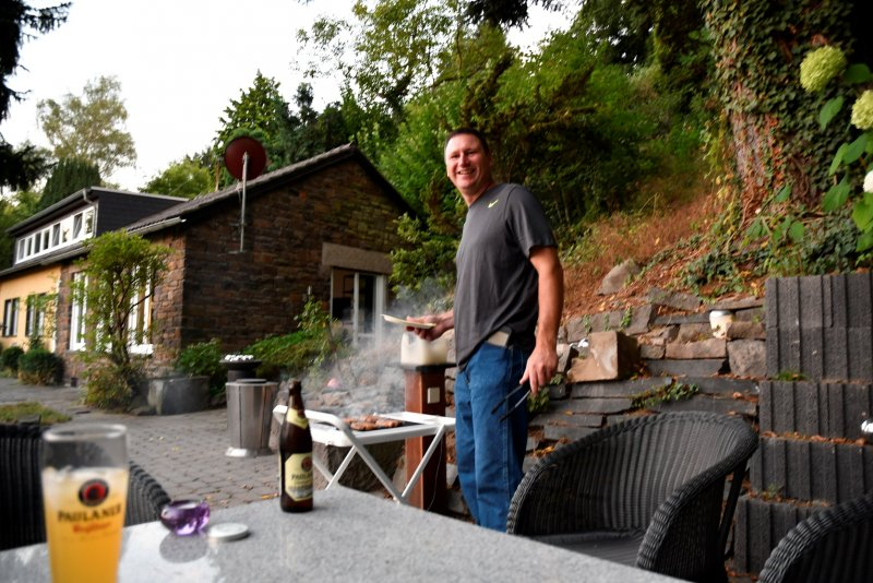 Dan cooking outside on the grill at the house we rented Andernach Germany by the Rhine RIver.