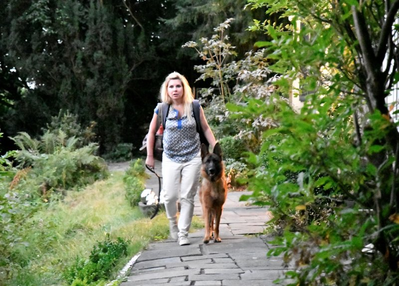 Karen bringing her dog home at the Andernach house. June had been in training in Germany.