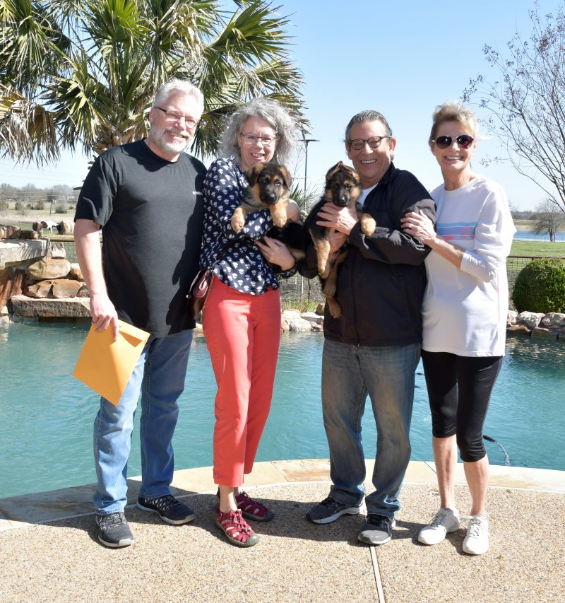 Zuriel with his new owners Louis and Martha Felini and Heidi with her new owners Mike and Sharon Naftel. Picture taken on March 09, 2019