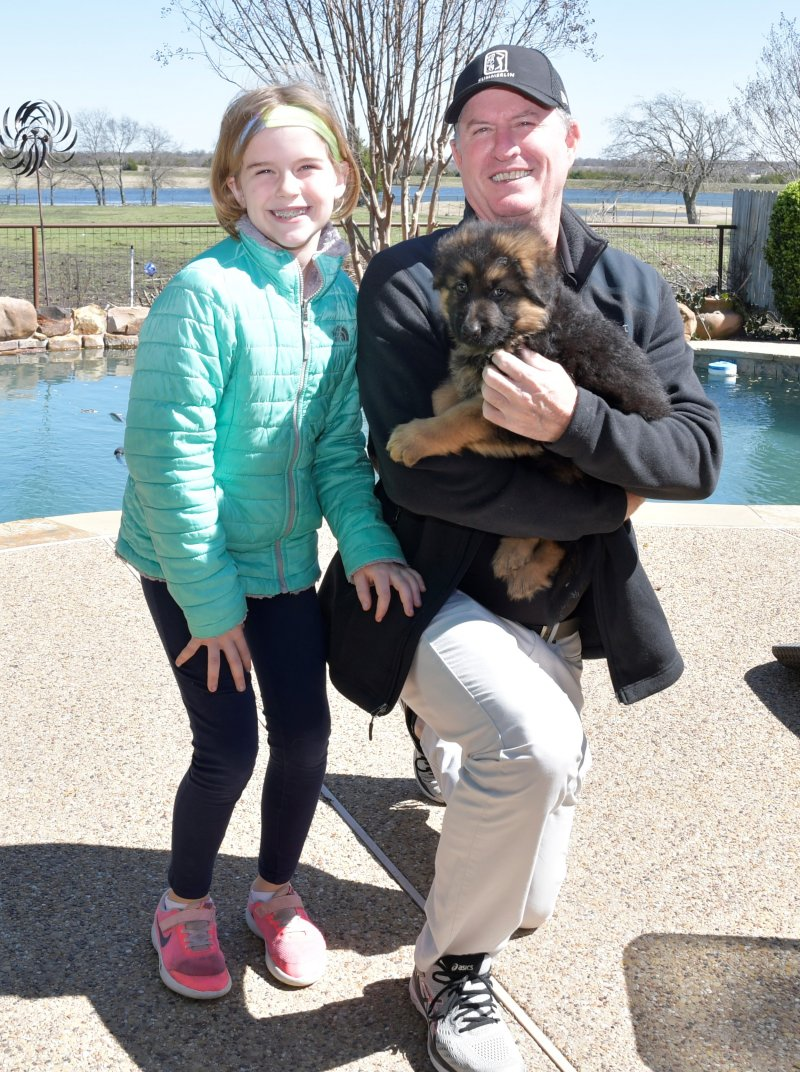 Rio a Nix and Emma male with his new owners James Kelly Russell and his daughter. Picture taken on March 09, 2019